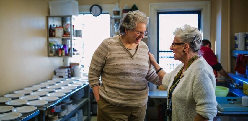 Sister Sarah Crotty, left,  talks with long time volunteer Nancy Hager in the kitchen at the Focus on Renewal Community Center in McKees Rocks on January 25, 2016.