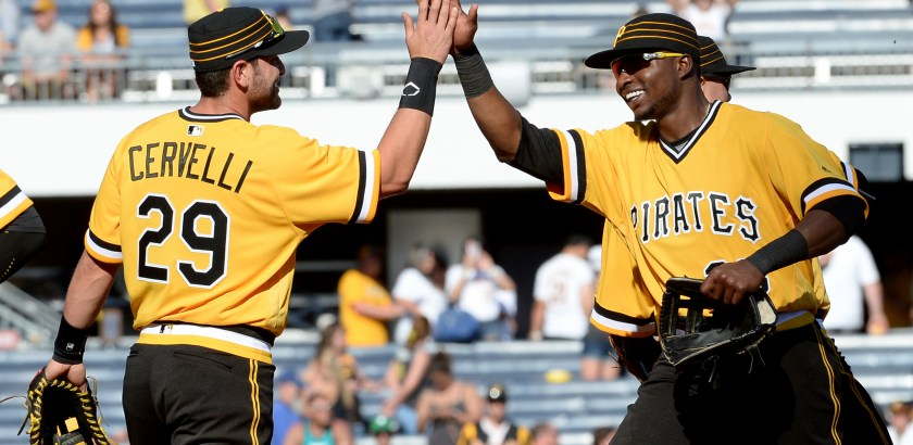 Matt Freed/Post-Gazette Pirates' Francisco Cervelli celebrates with Gregory Polanco after defeating the Brewers Sunday at PNC Park.
