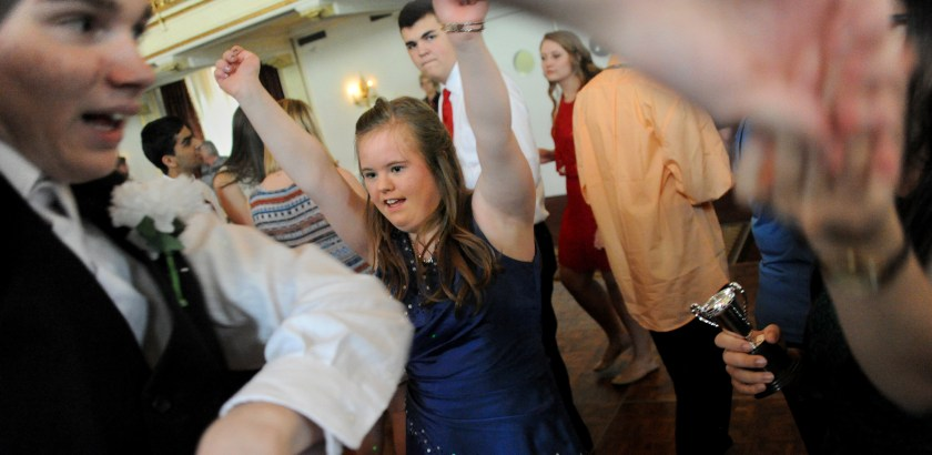 Lake Fong/Post-Gazette 04272016 Standalone Local Imogen Snowdon, a 10th grader of Upper St. Clair High School, dances with her classmates at Prom for Students with Disabilities at the Omni William Penn Hotel on Wednesday, April 27, 2016. More than 150 students and their peer partner dates from 16 school districts, who regularly meet monthly to interact for social and educational opportunities participate in the prom together.