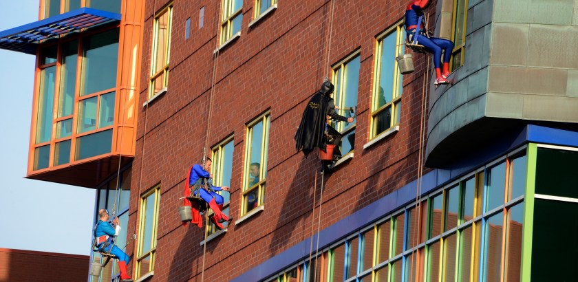 Darrell Sapp/Post-Gazette / Pittsburgh — 04/21/2016 — for Local— STAND ALONE — Superheroes Cleanup— Captain America,Steve Virag, Superman,Ed Hetrick,  Batman, Jim Zaremba and Spiderman , Rick Bollinger, all with Allegheny Window Cleaning Inc., work on the exterior of the widows  of Children's Hospital of Pittsburgh of UPMC.           digital image #dsc5524                    slug — 20160421dsSuperheroesLocal02.jpg