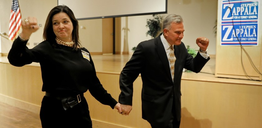 Matt Freed/Post-Gazette Attorney General candidate Stephen Zappala walks to the podium with his wife Mary to concede to Josh Shapiro Tuesday at IBEW Local 5 on the South Side.
