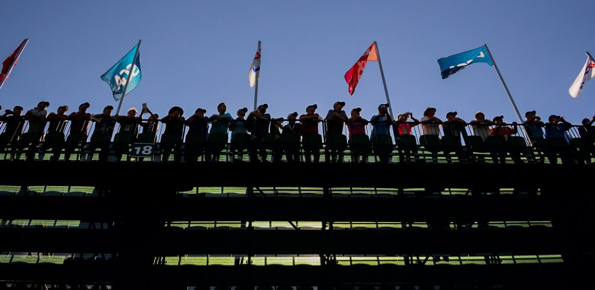 Spectators watch from the stands near the 15th hole on Friday. (Lake Fong/Post-Gazette)