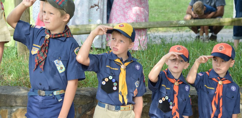 Nicholas Koreny (cq), Eli and Nate Meeder (cq), and Logan Tustin (cq), Boy Scouts from Greensburg Troop 476, stand in attention during the flag raising ceremony. (Gracey Evans/Post-Gazette)