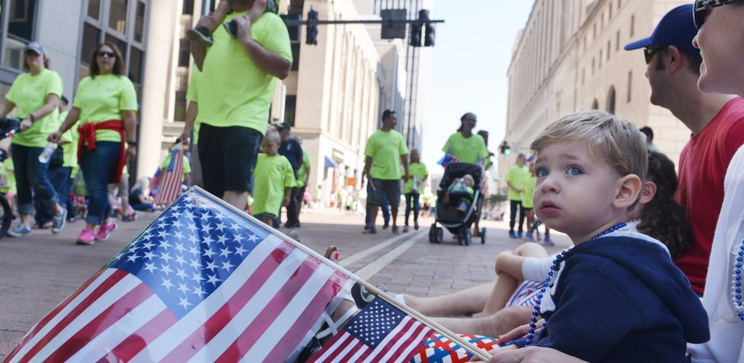 Nate Guidry/Post-Gazette. 20160905. For local. Parade.  Nathan Thomas, 2, along with his sister Bridget, 4, and their parents Lacey and Chris Thomas, watch the Pittsburgh Labor Day parade as it winds down Grant Street Monday Sept. 5, 2016.