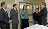 Banco Popular and RIncn Health Center executives walk through the future health facility.