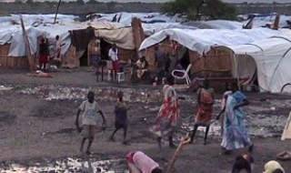 "A grab made from a video released by the United Nations Mission in South Sudan (UNMISS) on April 23, 2014 shows displaced people in a camp in Bentiu, on April 22, 2014. Rebel gunmen in South Sudan massacred ""hundreds"" of civilians in ethnic killings when they captured the oil town of Bentiu last week, the UN said on April 21, one of the worst reported atrocities in the war-torn nation. In the main mosque alone, ""more than 200 civilians were reportedly killed and over 400 wounded,"" the UN mission in the country said, adding there were also massacres at a church, hospital and an abandoned UN World Food Programme (WFP) compound.  AFP PHOTO / HO / UNMISS  RESTRICTED TO EDITORIAL USE - MANDATORY CREDIT ""AFP PHOTO / HO / UNMISS "" - NO MARKETING NO ADVERTISING CAMPAIGNS - DISTRIBUTED AS A SERVICE TO CLIENTS"