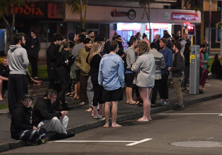 epa05629748 People evacuated from buildings along Dixon Street, Wellington after an earthquake based around Cheviot in the South island shock the capital, New Zealand, early 14 November 2016. According to reports, a 7.4. earthqauke has hit New Zealand overnight, triggering a tsunami warning for the east coast of the country.  EPA/ROSS SETFORD
