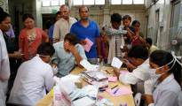 Indians suffering from fever get their blood test for dengue at a fever clinic run by a government hospital in New Delhi, India, Thursday, Sept. 17, 2015. India's capital struggles with its worst outbreak of the dengue fever in five years. Outbreaks of the mosquito-borne disease are reported every year after the monsoon season that runs from June to September. (AP Photo/Manish Swarup)
