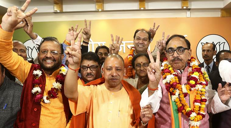 Uttar Pradesh Chief Minister Yogi Adityanath along with BJP state President Mahenra Narth Pandey and other party leaders celebrating victory in Urban,Local body elections at state party head office in Lucknow on friday.Express photo by Vishal Srivastav 01.12.2017