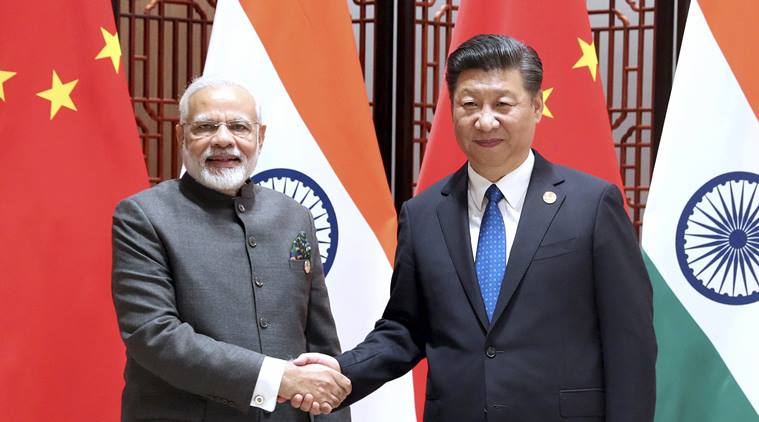 "Xiamen : In this photo released by China's Xinhua News Agency, Indian Prime Minister Narendra Modi, left, and China's President Xi Jinping shake hands as they pose for a photo during a meeting on the sidelines of the BRICS Summit in Xiamen in southeastern China's Fujian Province, Tuesday, Sept. 5, 2017. India's foreign secretary says the leaders of China and India have emphasized that peace and tranquility in their border areas is a ""prerequisite"" for the further development of their relationship.AP/PTI(AP9_5_2017_000058B)"