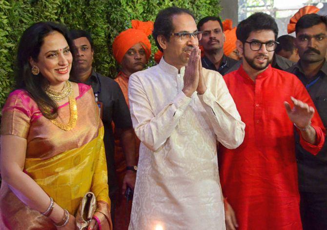 Mumbai: Shiv Sena chief Uddhav Thackeray with wife Rashmi and son Aditya arrive to attend the wedding ceremony of MNS Chief Raj Thackeray's son Amit Thackeray who tied the knot with Mitali Borude, in Mumbai, Sunday, Jan 27, 2019. (PTI Photo) (PTI1_27_2019_000107B)