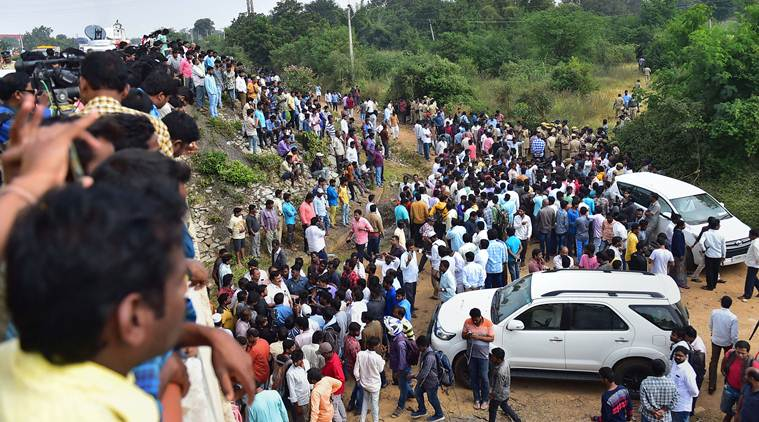 Hyderabad: Onlookers gather near the encounter site, where four accused in the rape-and-murder case of a 25-year-old woman veterinarian were shot dead by police, at Shadnagar of Ranga Reddy district in Hyderabad, Friday, Dec. 6, 2019. (PTI Photo/Shailendra Bhojak)(PTI12_6_2019_000124A)