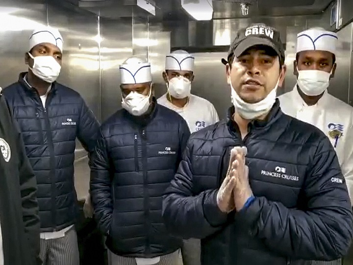 **EDS: SCREENGRAB FROM A FACEBOOK VIDEO** New Delhi: In this screengrab of a SOS video Binay Kumar Sarkar (R) along with other Indian crew members of the quarantined cruise liner Diamond Princess, requests Prime Minister Narendra Modi to save them and the passenger. The coronavirus tally at the ship touched 137 Monday after 66 more passengers and crew members were tested positive for the infection. (SCREENGRAB/PTI Photo) (PTI2_10_2020_000203B)