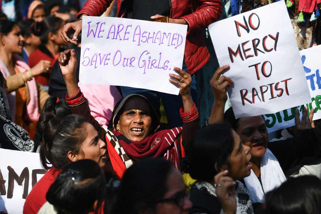 Social activists and supporters shout slogans to protest against the alleged rape and murder of a 27-year-old veterinary doctor in Hyderabad, during a demonstration in New Delhi on December 3, 2019. (Photo by Sajjad  HUSSAIN / AFP) (Photo by SAJJAD  HUSSAIN/AFP via Getty Images)