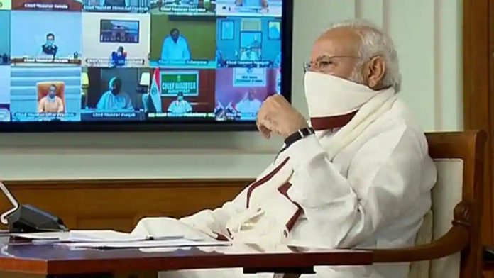 PM-Narendra-Modi-sets-an-example-wearing-a-homemade-mask-in-CM-meeting-696x392