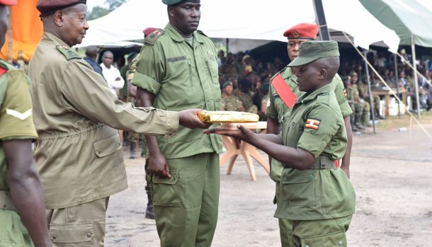 President Museveni admires UPDF soldiers clad in locally made uniforms