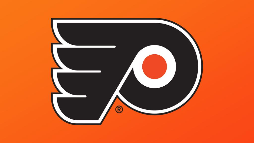 Flyers reduce training camp roster by four