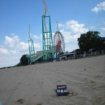 Three Daves lounges on the beach at Cedar Point, contemplating a wild ride.