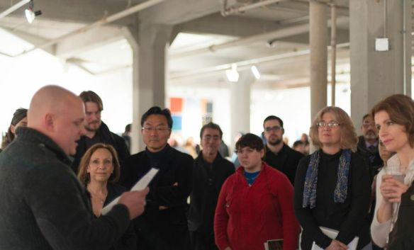 A reading during the From Motion to Stillness opening, photo by Jennifer Koe.