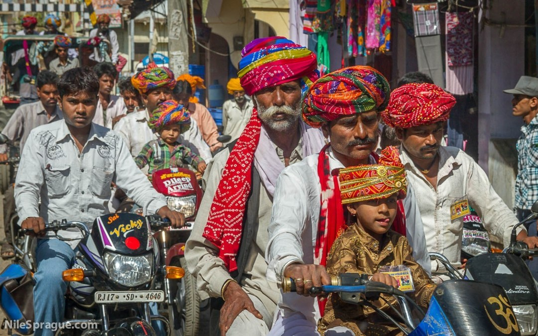 Photo: Men and Boys with colorful turbans riding motorcycles, Chau Mahla District, Rajasthan, India.