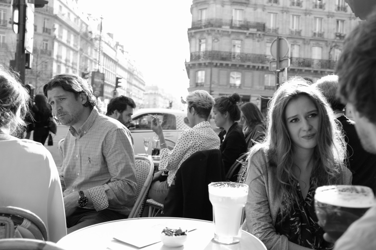 Parisians at a café on the Left Bank, engaging in the most Parisian of activities. Paris, March 2014. Photo by Callie Neylan.