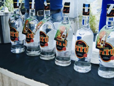 Pretty bottles of pitu in a row