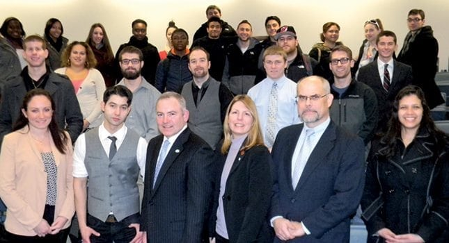 NJM Insurance Group President and CEO Bernie Flynn (front row - third from left), with William Paterson University students and NJM employees Dawn Paquette and Eric Stenson (front row - third and second from right, respectively).