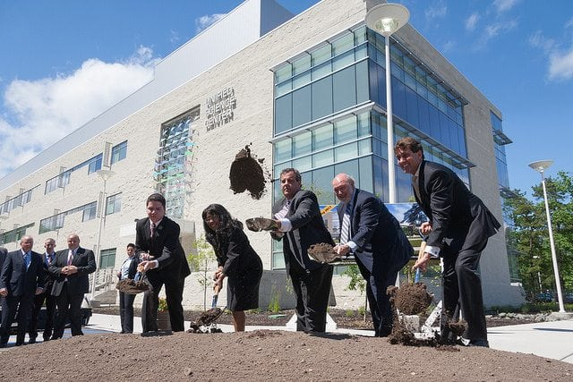 From the left, Carl Archut Jr, Student Senate president, the Honorable Rochelle Hendricks, secretary of Higher Education, Governor Chris Christie, President Herman Saatkamp, and Curtis Bashaw, chair of the Board of Trustees, break ground at the site where the Unified Science Center addition will be built.