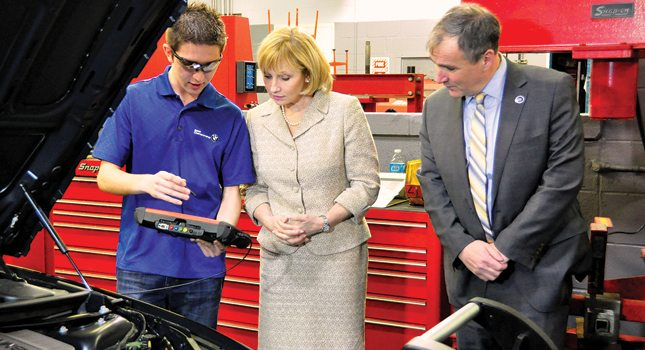 Lt. Governor Kim Guadagno (center) and New Jersey Department of Labor & Workforce Development Commissioner Harold Wirths tour the Bergen Tech/Teterboro automotive engineering and design technology program, which is operated through a partnership with BMW North America.