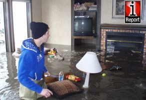 The levee in iReporter Peter Frei's front yard broke on Thursday south of Fargo.