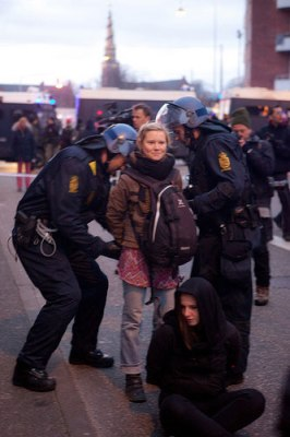 girl arrested in Copenhagen a 266x400 100,000 protest in Copenhagen, police arrest 1,000 photo