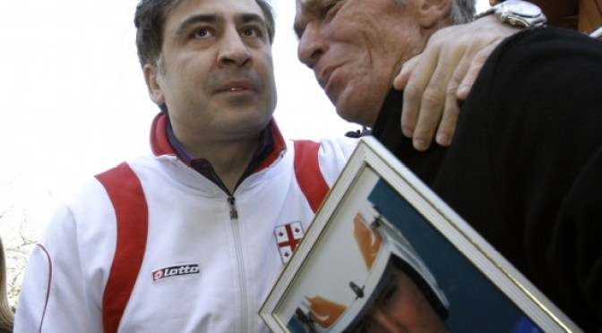 David Kumaritashvili, father of Georgian luge competitor Nodar Kumaritashvili, receives condolences from Georgia's President. (Reuters Photo)