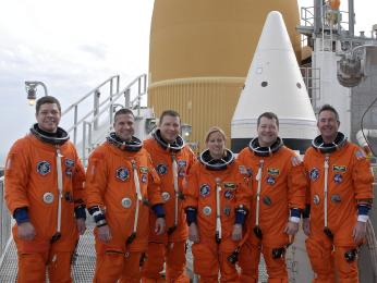 At Launch Pad 39A at NASA's Kennedy Space Center in Florida, the crew of space shuttle Endeavour's STS-130 mission posed for a group portrait