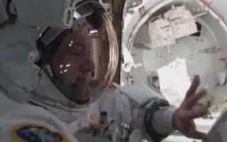 Astronauts return from EVA 1