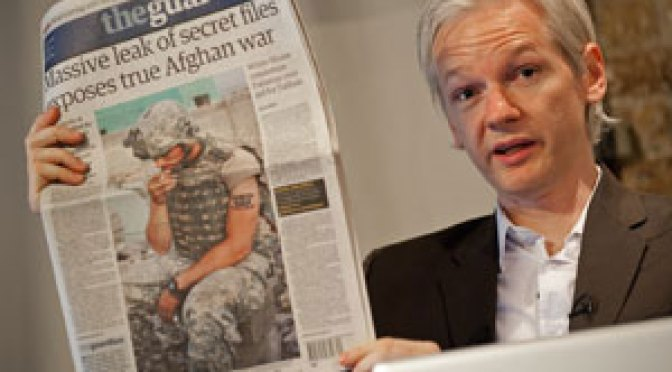 Australian founder of whistleblowing website, 'WikiLeaks', Julian Assange, holds up a copy of today's Guardian newspaper during a press conference in London on July 26, 2010. (LEON NEAL/AFP/Getty Images)