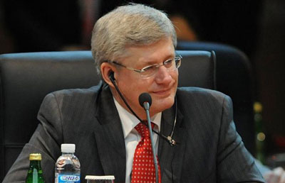 Canadian Prime Minister Stephen Harper in Santiago Chile, not happy with our Charter (Photograph by: SAUL LOEB , Getty Images Canada.com)