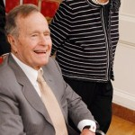 Former President George H Bush jokes put the harps back in the closet