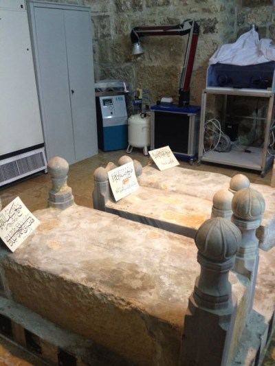 image of three sarcophagi surrounded by equipment, al Haram al-Sharif Jerusalem