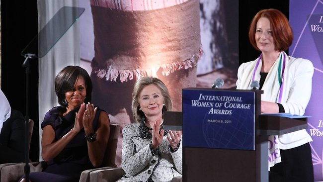 199903-michelle-obama-and-hillary-clinton-applaud-julia-gillard