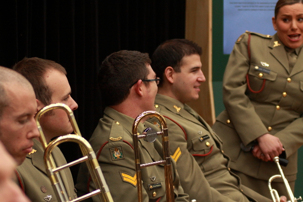 Members of the army band relax before the official party take the stage to open the Spirit of Anzac exhibition. Photo: Wayne Jansson