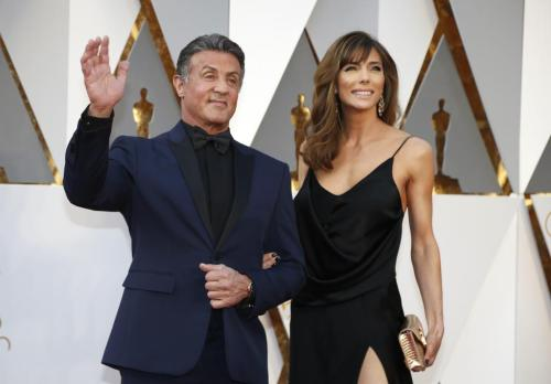 "Sylvester Stallone, nominated for Best Supporting Actor for his role in ""Creed,"" and wife Jennifer Flavin. REUTERS/Lucy Nicholson"