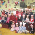Tuesday, February 14, the children are wearing their festive hearts and reds and pinks to celebrate Valentine's Day with Ms. Marylou.