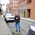 Ken Rothman of Salem Street True Value Sweeping In Front of His Store (Photo by Matt Conti)