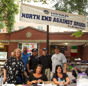 From the left, standing, Debra Decristoforo, Al Vilar, Officer Teddy Boyle, Treas. Steve Grossman, NEAD President John Romano. Sitting are Karen D'Amico (left) and Olivia Scimeca. (Photo by Matt Conti)
