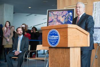 Mayor Thomas M. Menino announces actions to prepare and react to storms caused by rising tides. Also pictured, Brian Swett, Chief of Environment &amp; Energy.