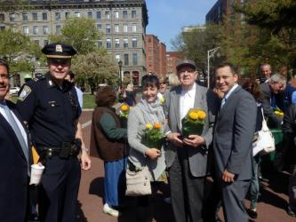 BPD Captain Thomas Lee (left) and State Rep. Aaron Michlewitz (right) with Chris Fincham and neighbors
