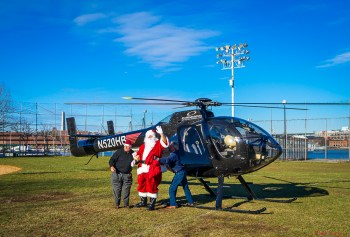 Santa comes out of his helicopter (Photo by Matt Conti)