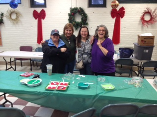 Kim Garofalo, Marie Musto, Madeline (Albano) Taranova and Patricia Romano showing off the Necklaces and bracelets to be made today at the Nazzaro Center.