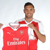 New signing Lucas Pérez holding Arsenal shirt