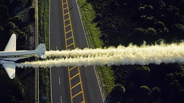 plane sprays pesticide by air
